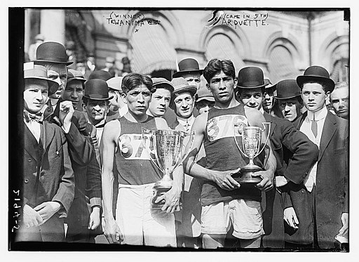 Photo shows Hopi American long distance runner and Olympic medal winner Louis Tewanima (1888-1969) and Mitchell Arquette, member of the cross country team of Carlise Indian School, after marathon in New York City, May 6, 1911. (Source: Flickr Commons project, 2009 and New York Times, May 7, 1911)