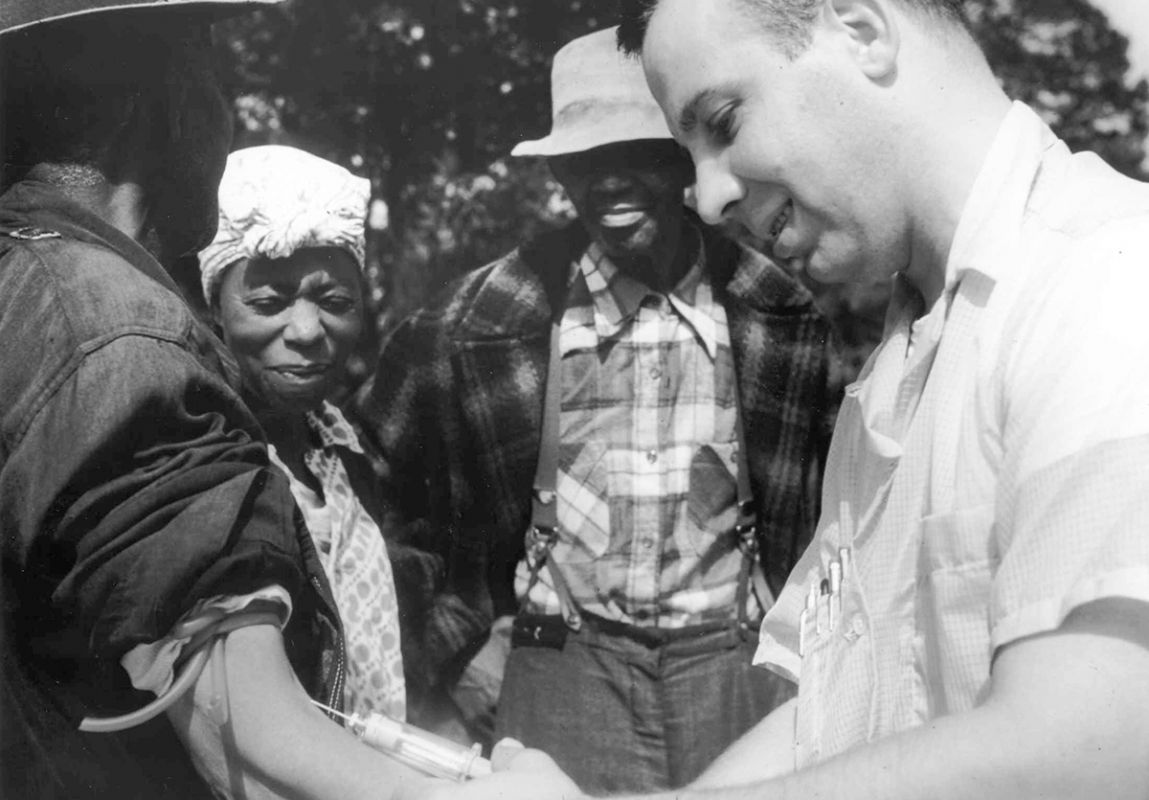 a doctor injects a Tuskegee syphilis study patient