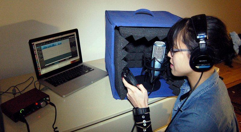 Image of woman recording at a comupter.