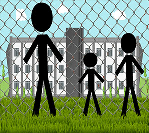 Three people of different heights standing in front of a chain link fence looking through at a building on the other side.
