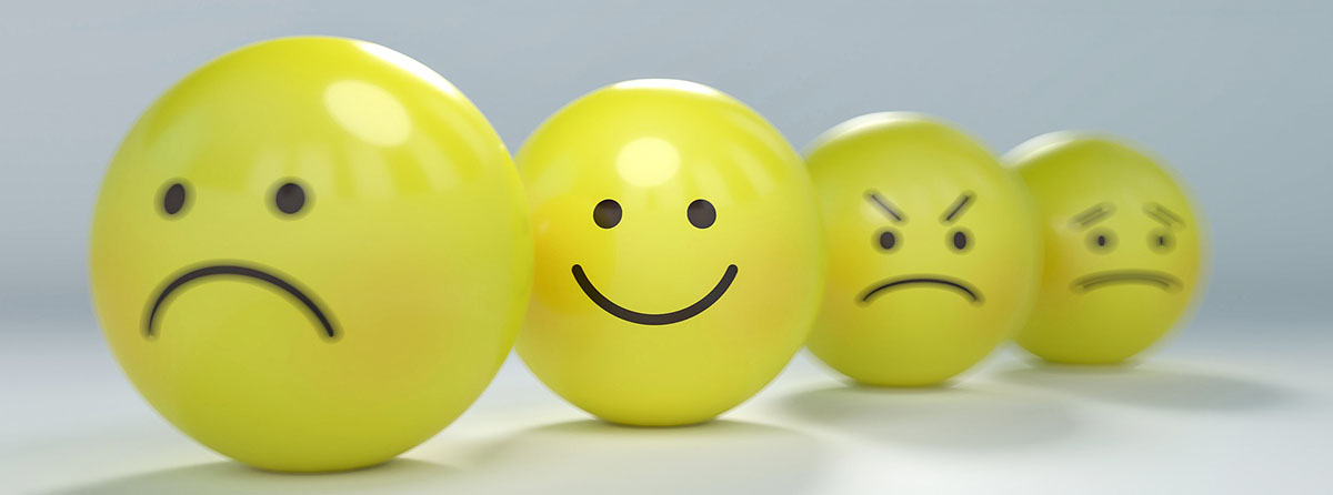 4 yellow balls with sad, happy, angry or worried faces