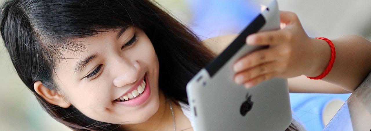 a girl with an ipad