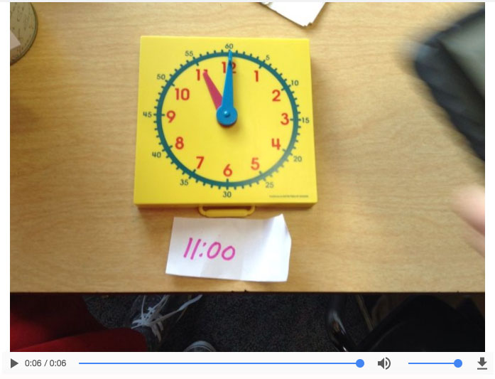 a plastic clock showing 11:00