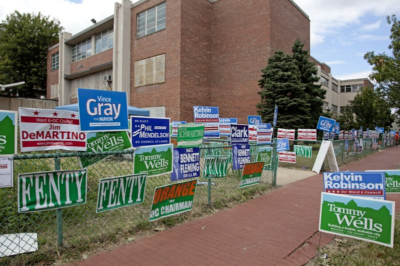 Political campaign posters at the Hine Junior High School, 8th St. near intersection with D St., SE, Washington, D.C