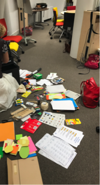 Floor space covered in prototyping kit papers and items