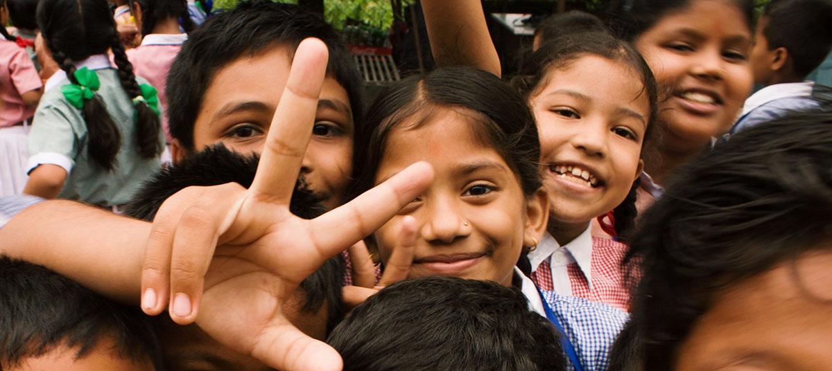 Many children smiling