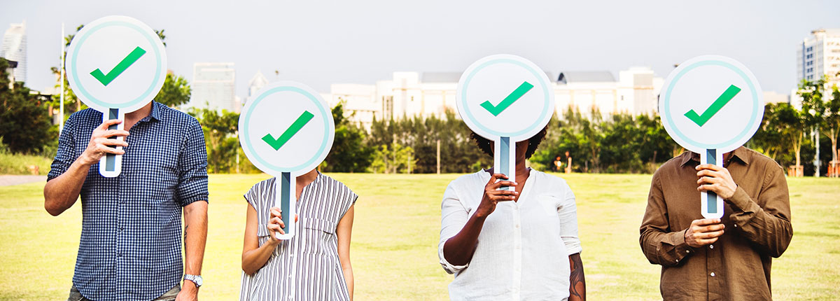 People holding checkmarks